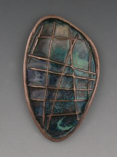 http://artinsilver.com/blog/wp-content/uploads/2009/05/t-torch-enameled.jpg, torch fired Hadar's Clay with copper enameling