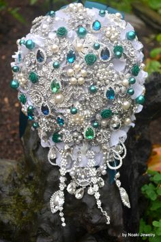 Cascading teal and emerald brooch bouquet