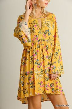 A super sweet yellow dress with bell sleeves and a flare! Pair it with brown or black boots and you'll look darling. This dress has the prettiest colors and is such a dream when you need something qui