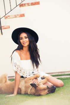 Celebrate #NationalPuppyDay With These Adorable Dog Photos: If you don't at least crack a tiny smile while staring at these adorable little faces, your heart might just be made of stone...or you're more of a cat person, in which case, just wait until October. -- Shay Mitchell and her dog.  | Coveteur.com