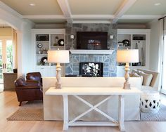 Stone fireplace, white built ins and white mantel