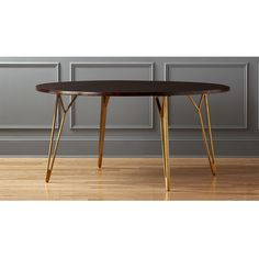 "Shop dial 60"" dining table.   Taking cues from midcentury design, we topped architectural brass legs with a warm walnut-stained shesham wood top.  A design twist that expertly combines modern with timeless."