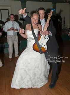 A Pittsburgh bride posed with the guitarist from City Heat band at her wedding reception. Guests had a blast dancing at the Soldiers and Sailors Memorial Hall, jamming to top hits and favorite old tunes. //  johnparkerbands.com