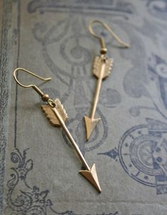 Hunger Games Brass Arrow Earrings.....  To bad I don't have my ears pierced.