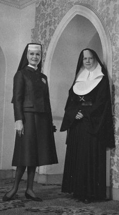 Stylish here: Model Bernice Pink wearing a nun habit designed by Catherine Scott. Beside her is Sister Mary Jeannine wearing the Sisters of Mercy's normal habit (1964).