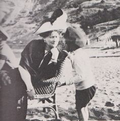 Empress Alexandra entertains her nephew, Prince Louis of Hesse on the beach near Livadia.