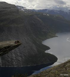 My husband is lying on the edge of Trolltunga, Odda, Norway. His son took this pictures with his camera.