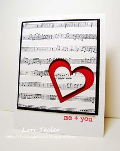 Love is a sweet song with this handmade Valentine's card featuring black and white musical notes with a red heart.