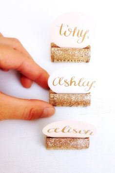 Glitter Wine Cork Place Card Holder for Wine Theme Wedding, Wedding Table Number Holder, Place Card Holders, Gold Glitter Wedding Decor by KarasVineyardWedding on Etsy https://www.etsy.com/listing/219879727/glitter-wine-cork-place-card-holder-for