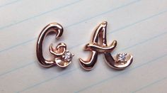Pink gold initials with diamonds