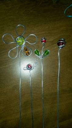 Wire wrapped marbles plant stakes.