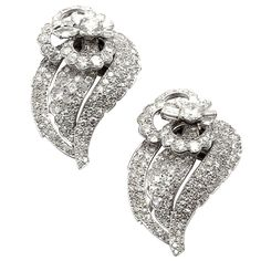 CARTIER PARIS Art Deco Pair of Diamond Brooches   From a unique collection of vintage brooches at https://www.1stdibs.com/jewelry/brooches/brooches/