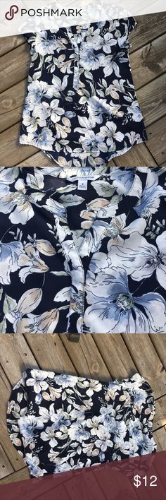 """Croft & Barrow short sleeve summer blouse VGUC.  High low hem and hidden front buttons.  Navy blue with a pretty floral print.  100% polyester.  Approx measurements:  ua to ua 19"""", back collar to hem 27 1/2"""", front is about 2 1/2"""" shorter. croft & barrow Tops Blouses"""