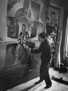 Salvador Dali (1904–1989) painting in his art studio | Vintage photo by Gisele Freund