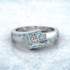 Metal Zig Zag Ring || Princess Cut Diamond Side Stone Ring With Ice Blue Topaz In 14K White Gold