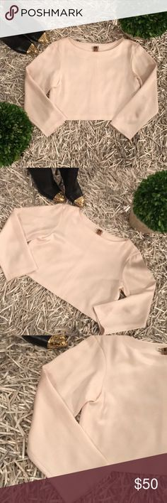 SALE🎉Club Monaco 3/4 sleeve crop top XS The perfect addition to your wardrobe, this top by Club Monaco goes well with high waisted skirts or pants.  The color is an off white and almost has a faint pink hue to it.  Soft and feels like silk but is a polyester and triacetate blend.  Worn gently but does have minor pilling.  I own another one in silver and love it!                                                                   💟 Open to reasonable offers only…