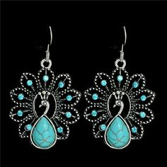 Peacock turquoise earrings New in package absolutely stunning matching necklace available Boutique  Jewelry Earrings