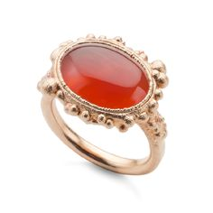 Oval Carnelian cabochon set in rose gold plated silver on a hammered band.Stone measures: 12 x 16mm