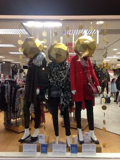 Christmas at @lovebeales Keighley store 2015 ladies fashion window #baubleheads #golddiscs