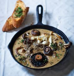 Mushrooms with roasted garlic cream and herb-buttered toast.