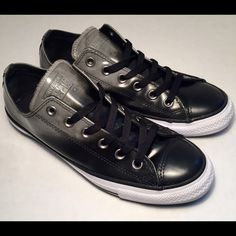Converse all star leather low top trainers Black and ombré gray low top limited edition leather Chuck Taylor's, size 7.5. An icon of cool with a leather retro touch. Cap toe, lace up, imported leather, brand label on tongue, shiny leather, rubber soul, padded insole and a modern touch to a classic shoe. These shoes are like new, comfortable and so so awesome Converse Shoes Flats & Loafers