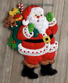 Bucilla 'Here Comes Santa' - Felt Wall Hanging - Stitchery Applique Kit - 86737 Christmas Stocking Kits, Felt Christmas Stockings, Felt Stocking, Felt Christmas Decorations, Felt Christmas Ornaments, Christmas Sewing, Christmas Crafts, Christmas Christmas, Table Decorations