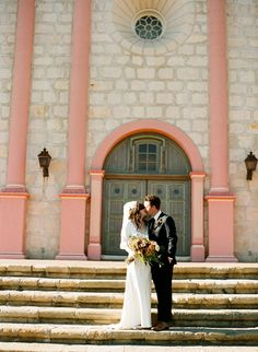 The Bride And Groom Share A Kiss On Steps Of Historic Santa Barbara Mission After Wedding Ceremony Photo By Ben Christensen Photography