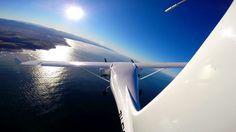 jabiru Twin flying over Garden Route coastline. Western Cape. South Africa