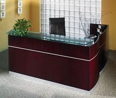Luxury Wood Veneer Reception Desk with Glass Transaction Counter from the Mayline Napoli Series Casegoods Furniture Collection at OfficeFurnitureDeals.com. #NapoliReceptionDesk #WoodReceptionDesk #ModernReceptionDesk
