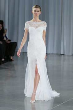 Monique Lhuillier fitted tulle dramatic slit in front.