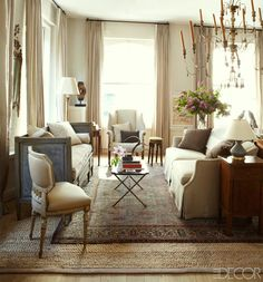 Gustavian Swedish Colors That Might Surprise You -  oriental rug laid over jute