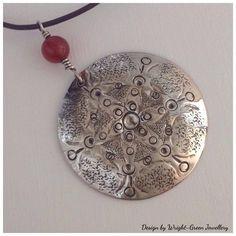 Silver disc design pendant