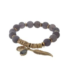 Gray and gold tone beaded stretch bracelet with a leaf charm.                                                                                                                                                                                 More
