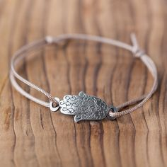 Give a helping hand and reach out with this empowering bracelet.