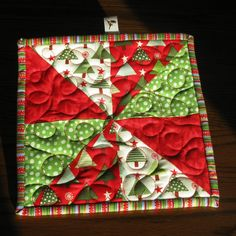 Hey, I found this really awesome Etsy listing at https://www.etsy.com/listing/169978614/quilted-christmas-potholder-hot-pad