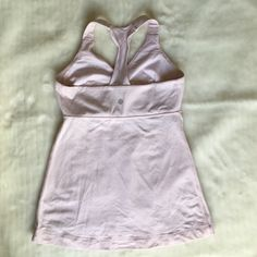 Lululemon Light Pink Tank Size 6 Preowned and in good condition Lululemon Light Pink Tank Size 6. Builtin bra. No pads. Please look at pictures and read description so you know what you are purchasing  lululemon athletica Tops