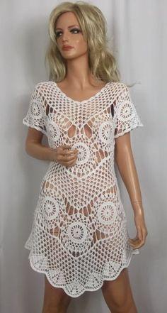 Sukieneczka hecho a mano ganchillo hilos 100% algodón en color blanco. Perfecto para el verano, la playa, a la fiesta. Tamaño 40,