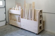 Lumber cart keeps timber organized with shelves to store long boards, upright bins for shorter pieces, and a large area to hold sheet goods. Lumber Storage Rack, Plywood Storage, Lumber Rack, Diy Garage Storage, Shed Storage, Tool Storage, Storage Cart, Rolling Storage, Workshop Storage