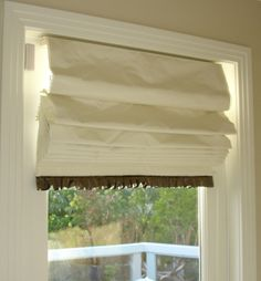 Soft fold roman shade with ruched trim at the hem.  This is a silk fabric with blackout lining.