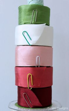 Use paper clips to hold ribbon on spools