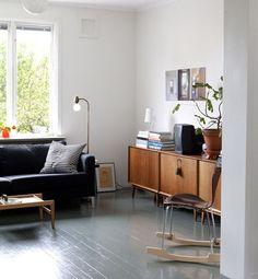 wood console, dark sofa
