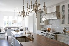 marble counters mixed w/wood island top; breakfast nook at end of kitchen; molding (not digging the chandeliers)