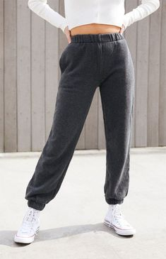 Stay comfortable all season long in the Rosa Sweatpants from John Galt. These sweatpants feature a high-rise fit, elastic waistband, side pockets, and cuffed ankles. Cute Lazy Outfits, Trendy Outfits, Cute Sweatpants Outfit, Baggy Sweatpants, Cute Pants, Grey Joggers, Midori, Champion Sweatpants, Lollapalooza