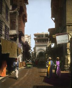 Men walk down a street in Cairo. | These Color Photos Of Cairo In 1910 Will Blow Your Mind