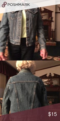 Jean jacket Levi , lights wasn't too good but here i is I am short waisted and busty goes below my waist bottom will hit at the waist on a taller woman Jackets & Coats Jean Jackets