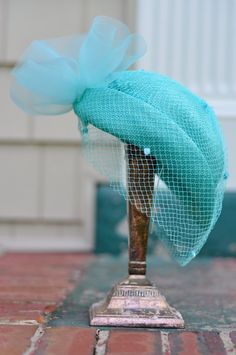 "Vintage hat- my grandmother wore a similar aqua hat with a lovely veil  to complement her Sunday best ""church suit"" and white gloves. She looked stunning!"