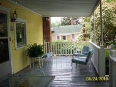 Historic property for sale in South Carolina - features an L-shaped porch.