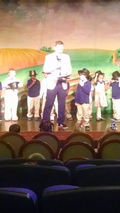 Okay, so I hate to admit it but I'm that mom, that pushes into the front to get a good shot of my baby at the PTA program. Or that mom that yells out her child's name as he enters the stage..