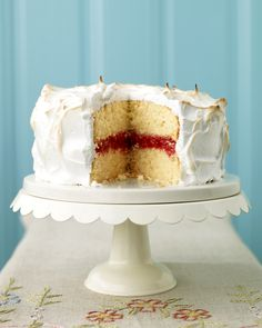 Meringue-Frosted Cake with Raspberry Filling: The cake layers can be baked, cooled, and wrapped in plastic up to a day ahead. Just before serving, spread filling over one layer, leaving a 1-inch border around the edge, then assemble the cake. When it's time for dessert, make the meringue, frost the cake, and brown it.