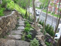 How to build a Natural stone retaining wall. The third tier in this backyard garden leading down to a busy boulevard. Gardens soften the look of the multiple stone walls. Backyard Garden Landscape, Backyard Fences, Backyard Landscaping, Sloped Landscape, Terraced Backyard, Big Garden, Landscaping Ideas, Dry Stack Stone, Stacked Stone Walls